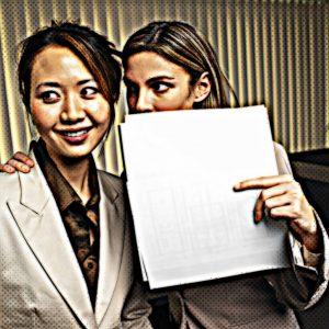 Two women in office gossiping
