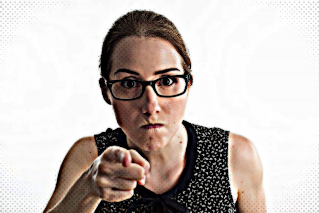 Mean looking woman pointing finger at someone